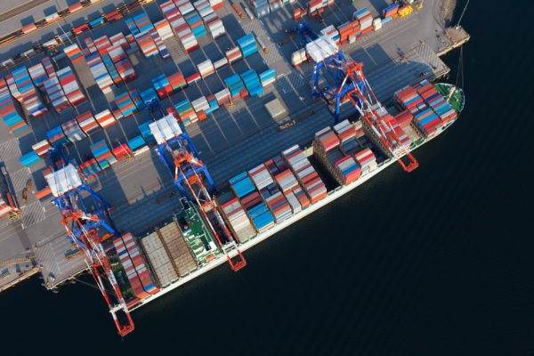 Aerial view of container ship at a port in British Columbia, Canada